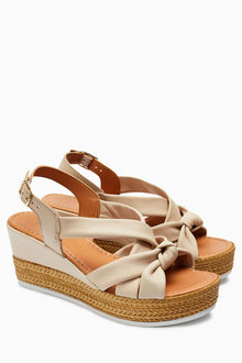 Next Knot Asymmetric Wedges